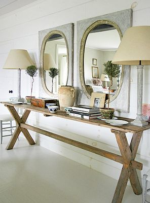 Slender table, double mirrors, double lamps and topiaries
