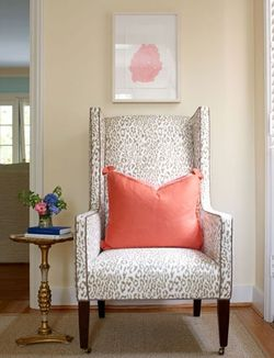 girly animal print chair with coral pillow