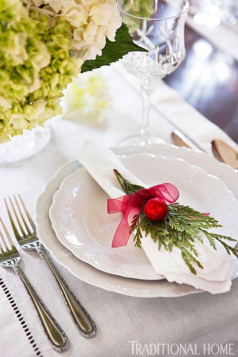 crisp white linens, red ribbons & greens.
