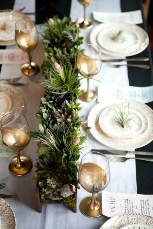 Holiday Table Setting with evergreen accents