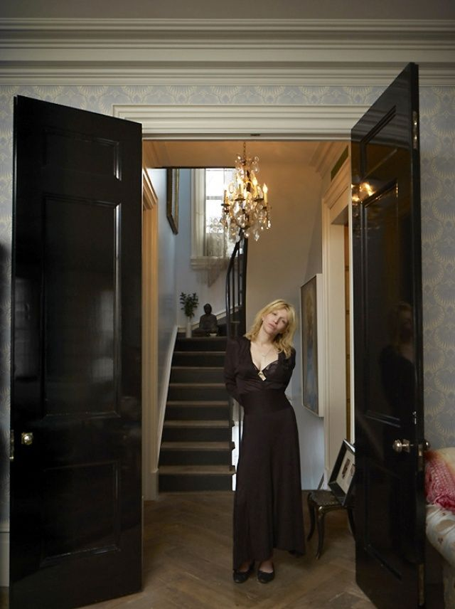 """From xojane.com: """"Courtney Love in the grand entry way [of her West Village NYC townhouse]?which leads from the living area to an upstairs bedroom. All clothing, Chanel."""
