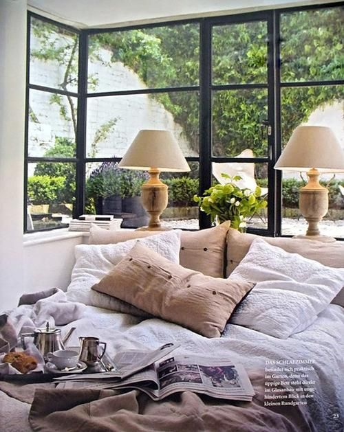 black outlined windows, clean and comfy bedroom