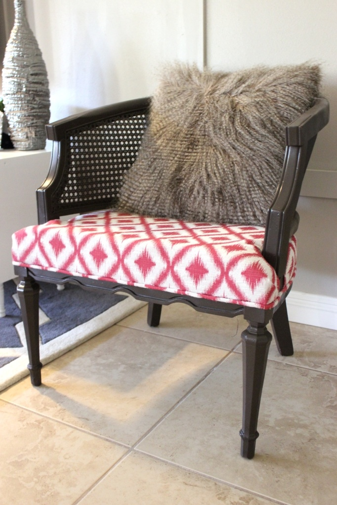 reupholstered cane chair - I just got two wicker chairs that I want to fix up ... might try to do this.