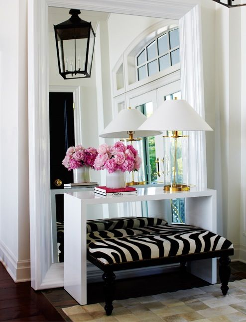 Love the big mirror & entry table