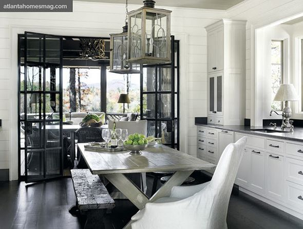 I'm not typically a black & white kitchen person, but I love this space, along with the dining area beyond the glass doors.