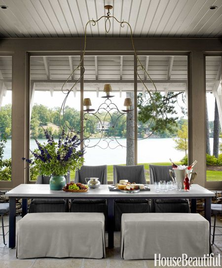 A screened dining porch with a chandelier from South of Market in Atlanta.