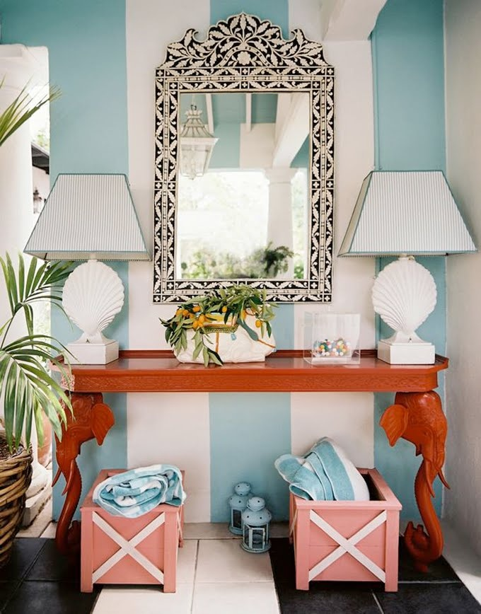 Blue and white striped walls with coral accent