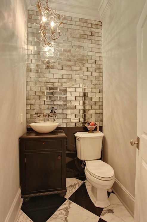 Check out this mirrored subway tile wall in this smashing powder room. #TileTuesday #TileSensations