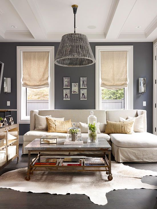 Living room color scheme: dark grey walls, white coffered ceiling, wide white trim, cream colored sofa