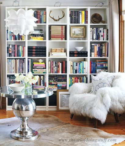 Vary Book Placement. Did you know there are 7 ways to stack books? Karen from The Art of Doing Stuff teaches us how she styled hers in her IKEA Billy bookcases to break up the columns. Notice how she doesn't just stick to books, she adds art and natural objects too. And don't you love that reading chair?