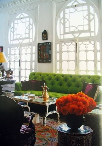 We love this take on a traditional sofa. The velvet makes it warm and inviting. The color makes it more modern or retro. Love this room! #green #sofa
