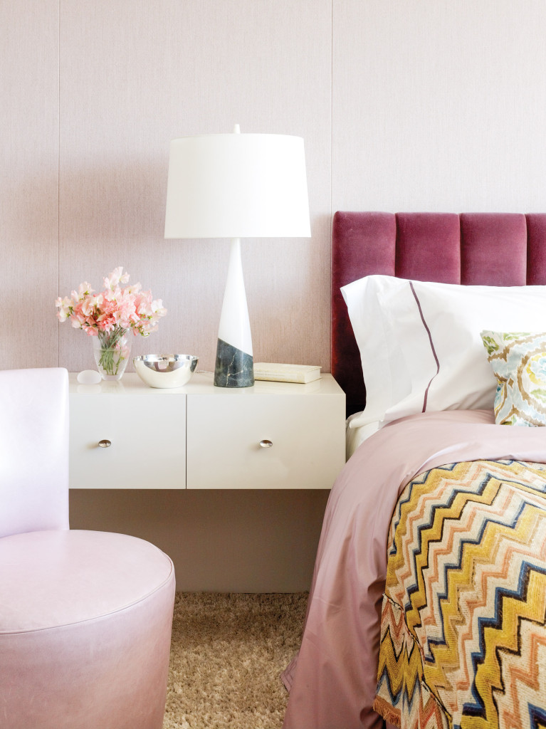 n the bedroom, a 1950s Italian alabaster lamp stands on a wall-mounted lacquered side table by Oldroyd.