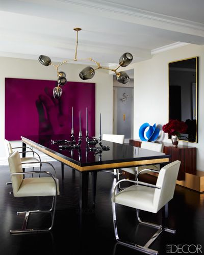 Ivanka Trump and Jared Kushner's Home - Designed by Kelly Behun - ELLE DECOR    {The Dining Room}    A Lindsey Adelman light fixture, a custom-made table, and Mies van der Rohe chairs upholstered in a Jerry Pair leather in the dining room; the candlesticks are by Jeff Zimmerman, and the walls are painted in Donald Kaufman's DKC-84.