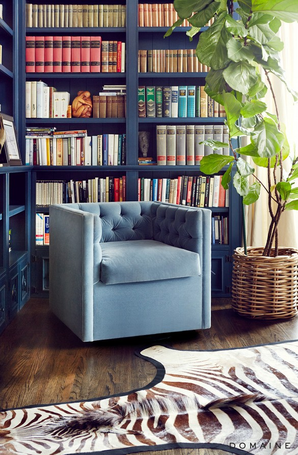 Library With Velvet Club Chair and Zebra Hide Rug