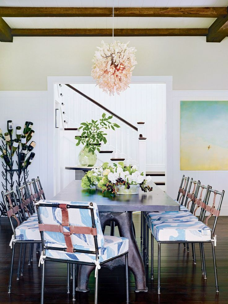 In the dining room, steel and leather chairs and a repurposed factory table continue Fulk's  industrial/vintage accents.