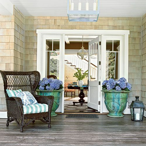 With a wide front porch, tons of wicker, and plenty of antiques, the house has as much classic style as an old Hamptons beach retreat. At the same time, batik prints, mercury glass accessories, and a mix of English and American antiques infuse the house with laid-back California cool and Old Hollywood glamour, too