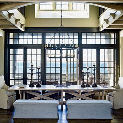 A stunning picture window and high ceilings allows the ocean to take center stage in this dining room.