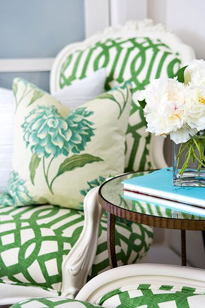 Preppy-chic pairing of geometric trellis fabric with a soft floral.  Simple color palate, & using similar scale on all prints keep this combo from reading as too busy.
