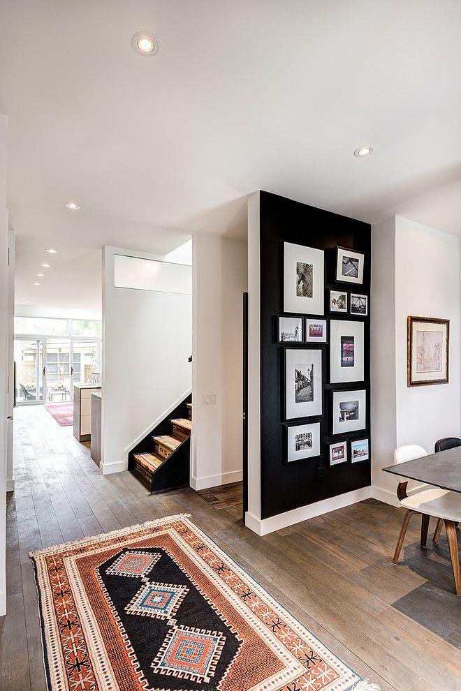Rug and black accent wall: Rug and black accent wall