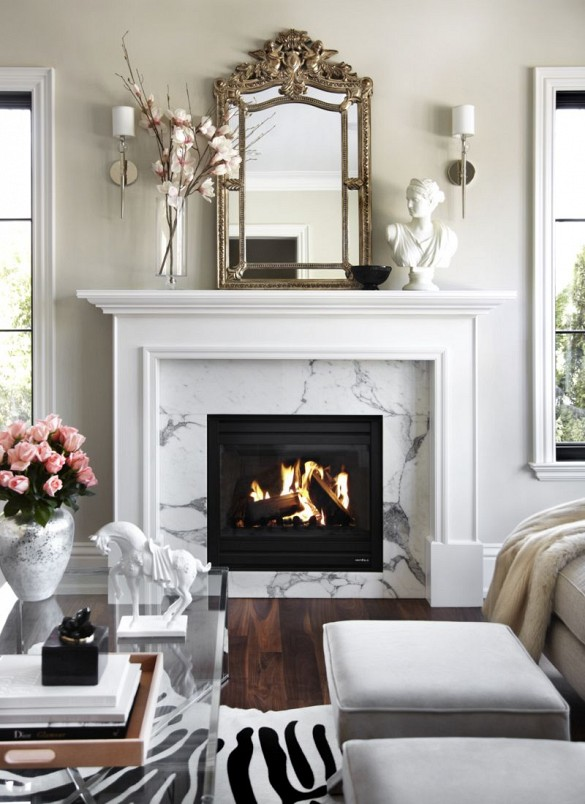 Fireplace with antique mirror, bust, and simple styling