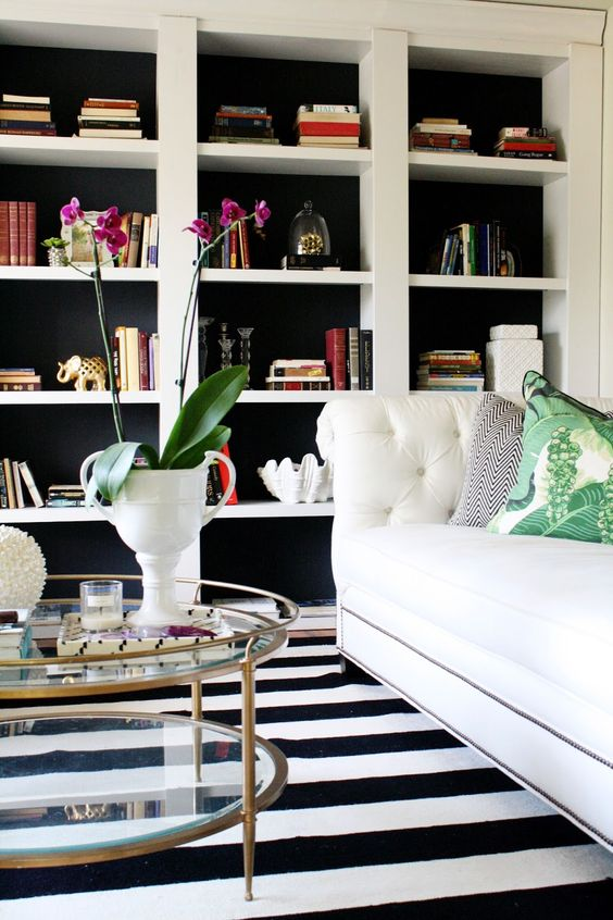 Take inexpensive bookcases from Target and turn them into built ins. Great hack and tutorial!  black and white living room.: