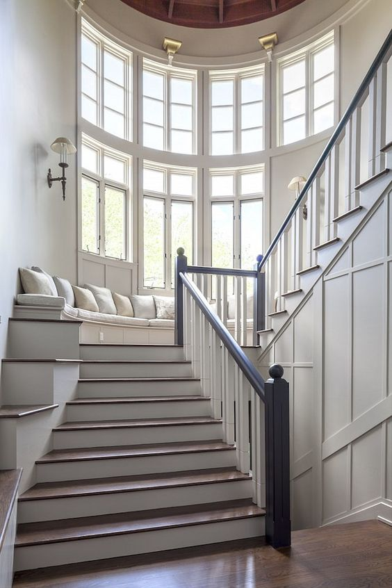 Stairway Bench. Stairway Window Bench. Stairway window seat Bench. Grand stairway with bench under wall of windows. #Stairway #Bench #Windowseat Via Christies Real Estate: