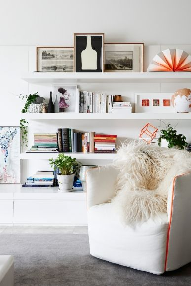 How plants can work in any interior style: An assortment of smaller platens decorate a shelf in this contemporary Melbourne home.: