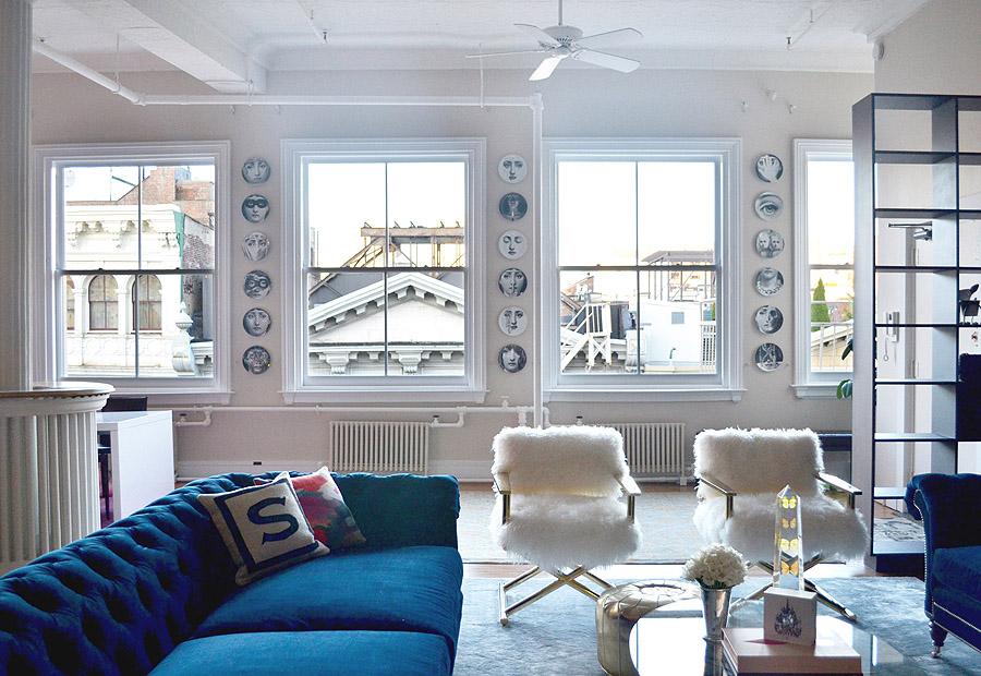 Soho NYC loft Tamra Sanford living room blue velvet sofas fuzzy chairs Fornasetti plates