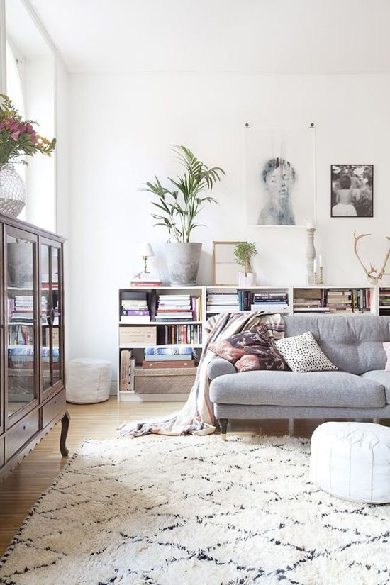 gray tufted sofa + low billy bookcases + beni + moroccan pouf: