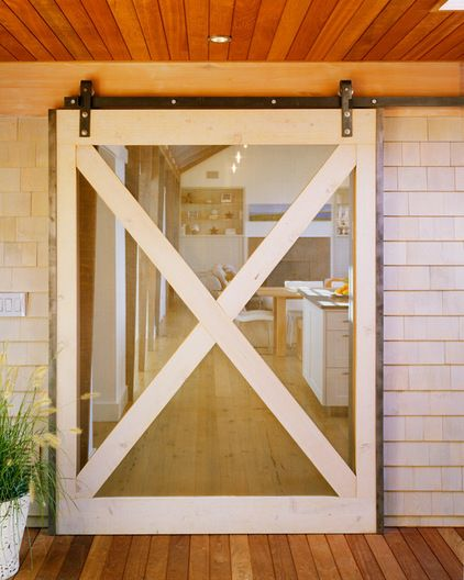 Barn-style screen door on a track. Looks so much more secure to hold up against the wind.: