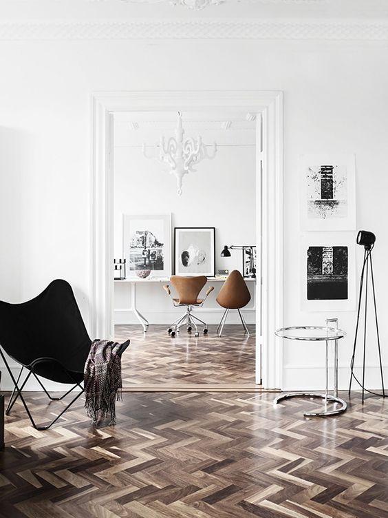 chevron wood floors, mid-century decor, clean white walls: