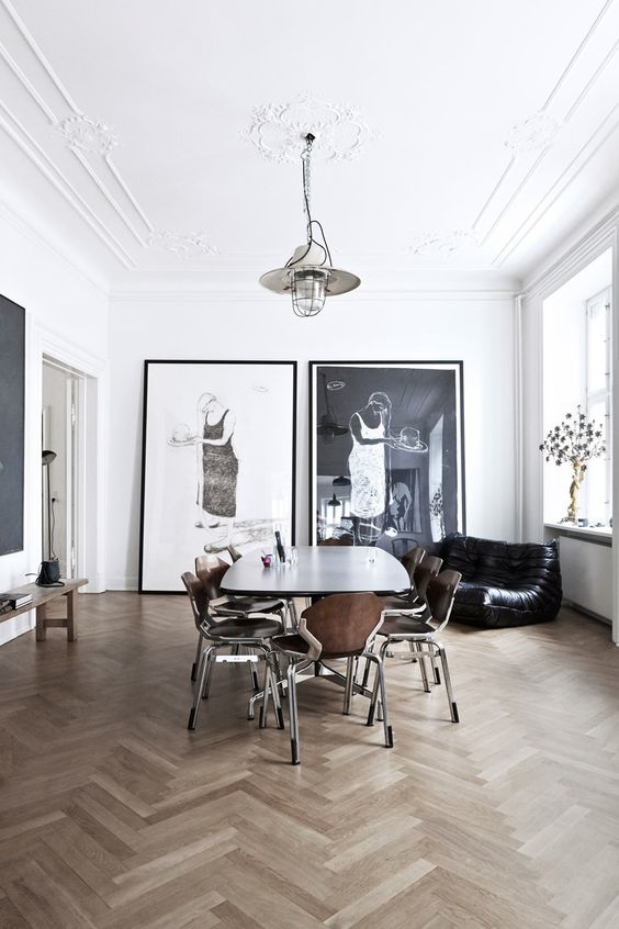 Oversized art, wishbone wooden flooring and a togo sofa.. Somewhere I would like to live.: