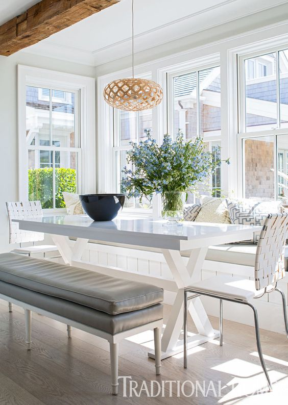 Sunlight streams in through double-hung windows surrounding the casual eating area. - Photo: John Bessler / Design: Cynthia Hayes: