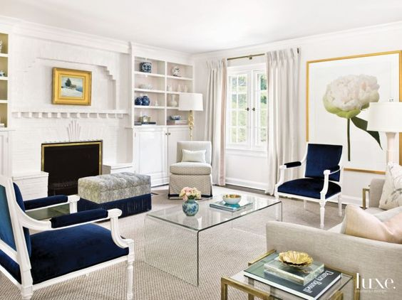 Paul Lange's Chloe photograph makes a statement in the living room. Here, Paschke grouped together Louis XVI-style armchairs upholstered in Old World Weavers fabric from Stark and an Edward Ferrell + Lewis Mittman slipper chair clad in Groundworks' David Hicks by Ashley Hicks textile from Lee Jofa. A custom ottoman is covered in an Alan Campbell fabric for Quadrille and Samuel & Sons bullion fringe. The coffee table was purchased through Wisteria.: