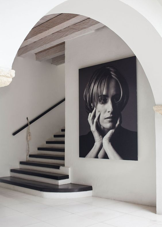 A black-and-white portrait of local fashion designer Silvia Tcherassi hangs prominently in the entryway of her eponymous hotel.: