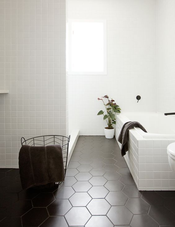 Black and white will never go out of style. Whether you have a lot to spend or just a little, bathrooms don't have to be boring!  Who lives here?  Chelsea Warburton (blogger and Instagrammer), James Warburton (founder and director of Create Group), Oliver, and Archie. The project The original 1960s bathroom was very old and dated. …: