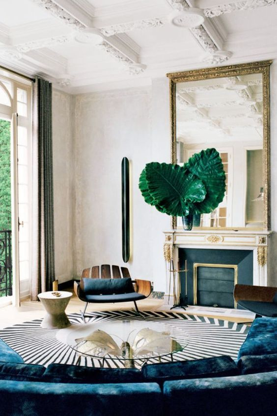 A sophisticated modern living room in an ornate Parisian apartment on @thouswellblog::