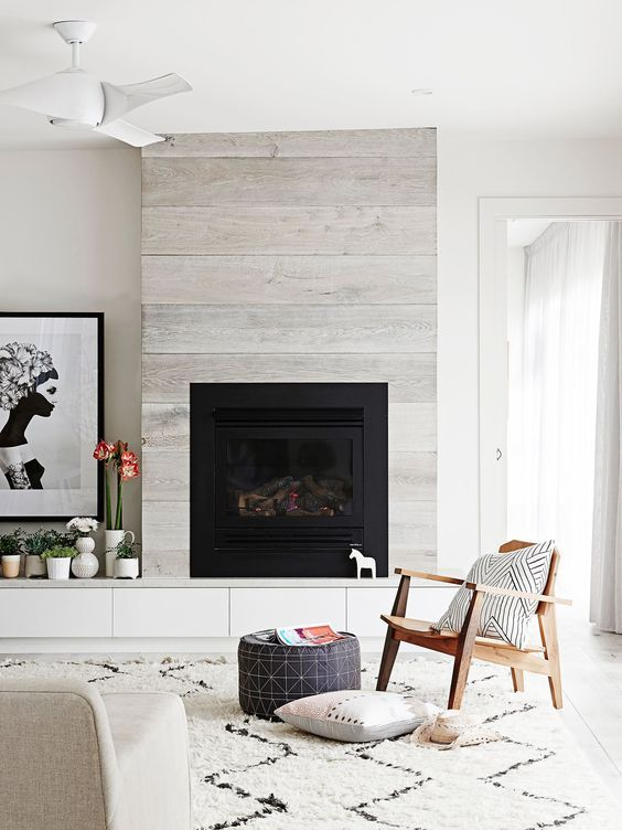 beautiful fireplace/ neutral midcentury living room: