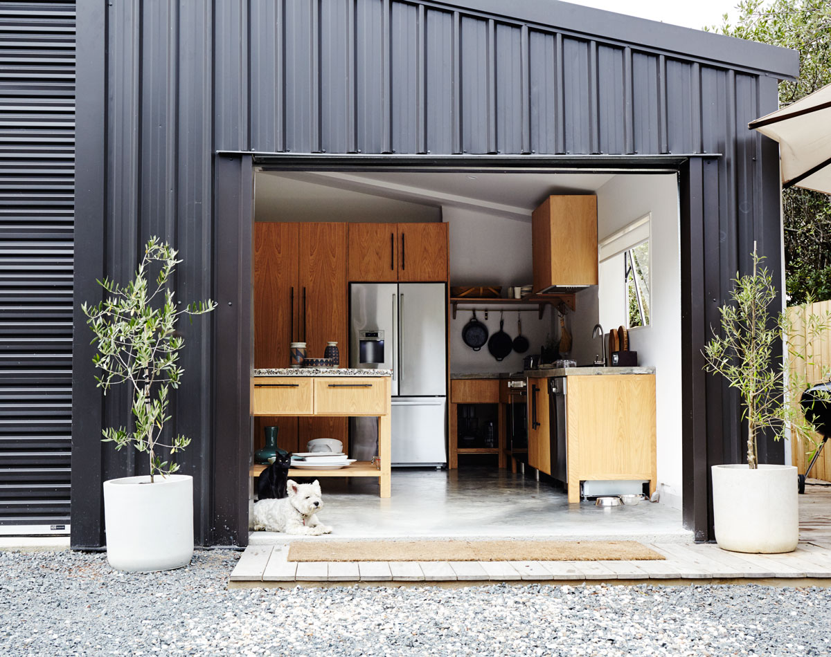 """About two years ago, my husband and I left Auckland and moved 45 minutes south of the city,"" says Dowie. ""We moved into a one-bedroom cottage before converting the barn we used as our workshop into the house you see now."""