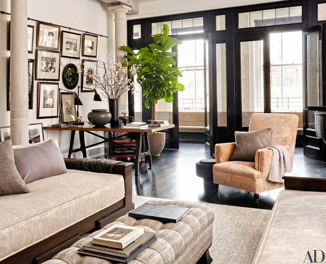 Light floods the living room in Meg Ryan's Manhattan apartment, where a pair of task lamps from Wyeth sit atop a vintage worktable, one of the actress's treasured finds.