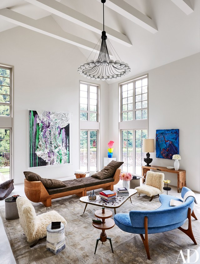living room with artworks by Anselm Reyle, Ugo Rondinone, and Zhu Jinshi
