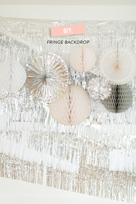 See How-To Make a Fringe Backdrop on #SMPLiving: http://www.stylemepretty.com/living/2013/12/11/silver-white-fringe-backdrop/ Eileen Ruth Photography